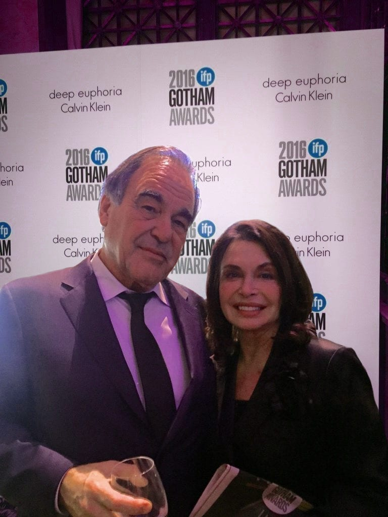 A celebration cheer with Oliver Stone. Tonight, he was honored at the Gotham Awards in New York City.
