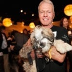 Development Board member and volunteer Wayne Gailis with homeless dog Apple Jacks - Photo by Sparenga Photograph