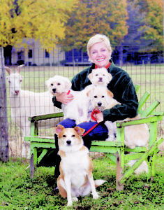 Paula Fasseas at her farm with dogs & goat