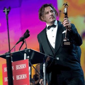 Johnny Depp receiving the Desert Palm Achievement Award