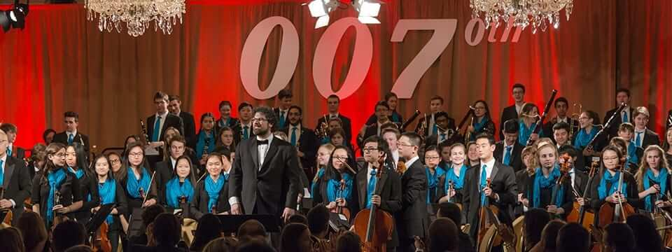 CYSO's Symphony Orchestra and Music Director Allen Tinkham look out on the audience at the 70th Anniversary Celebration