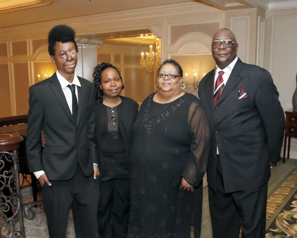 Scholarship recipient Joshua Dixon, Kimberley Rounds, Margaret and Byron A. Marrow