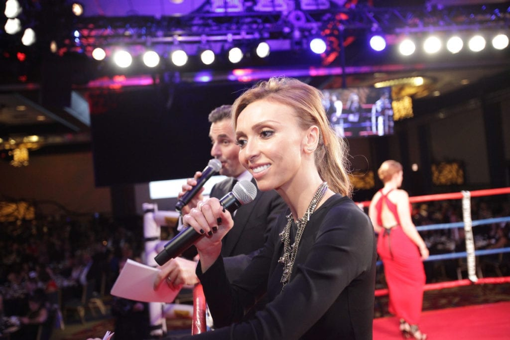Giuliana and Bill Rancic conduct live auction close up photo by Carlos J Ortiz
