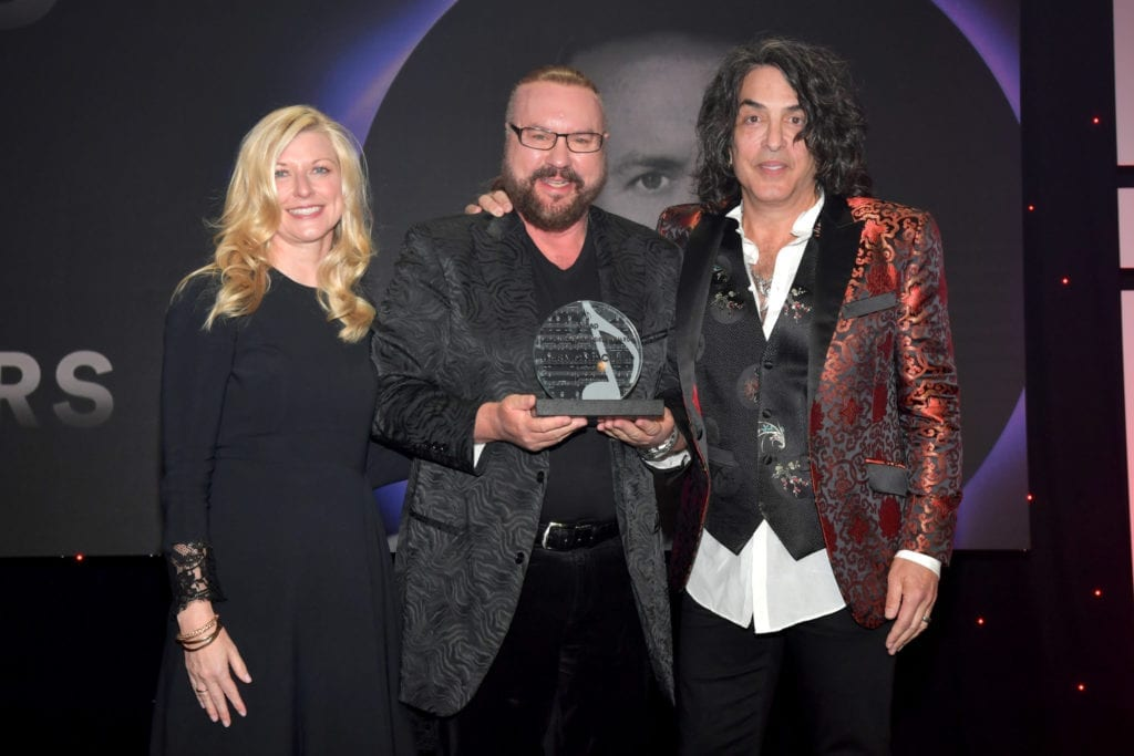 ASCAP Chief Executive Beth Matthews, from left, Desmond Child and Paul Stanley at the 35th annual ASCAP Pop Music Awards. Lester Cohen / Getty Images for ASCAP