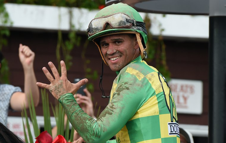Five up: Javier Castellano after winning his fifth Travers Stakes